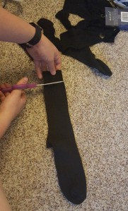 I first cut off the cuff at the opening of the sock.